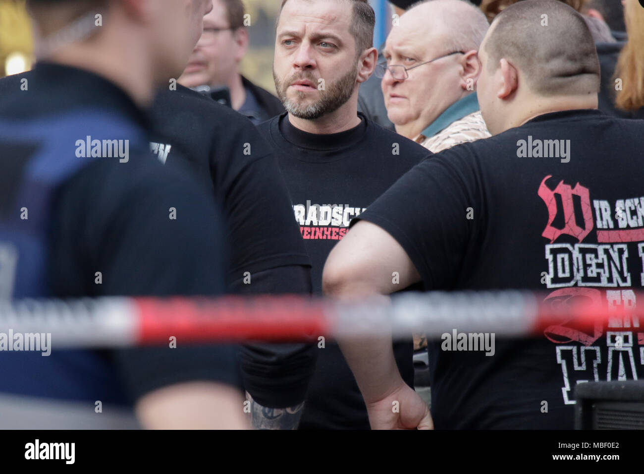 Mainz, Germany. 09th Apr, 2018. Members of the right-wing Kameradschaft Rheinhessen (comradeship Rhine-Hesse) can be seen at the protest, wearing t-shirts that read 'We swear the oath that lasts forever'. Around 50 right-wing protesters rallied in the city centre of Mainz, to protest against the German government, for the closing of the borders and against refugees under the slogan 'Merkel has to go'. They were heckled by around 400 counter-protesters. Credit: Michael Debets/Pacific Press/Alamy Live News - Stock Image