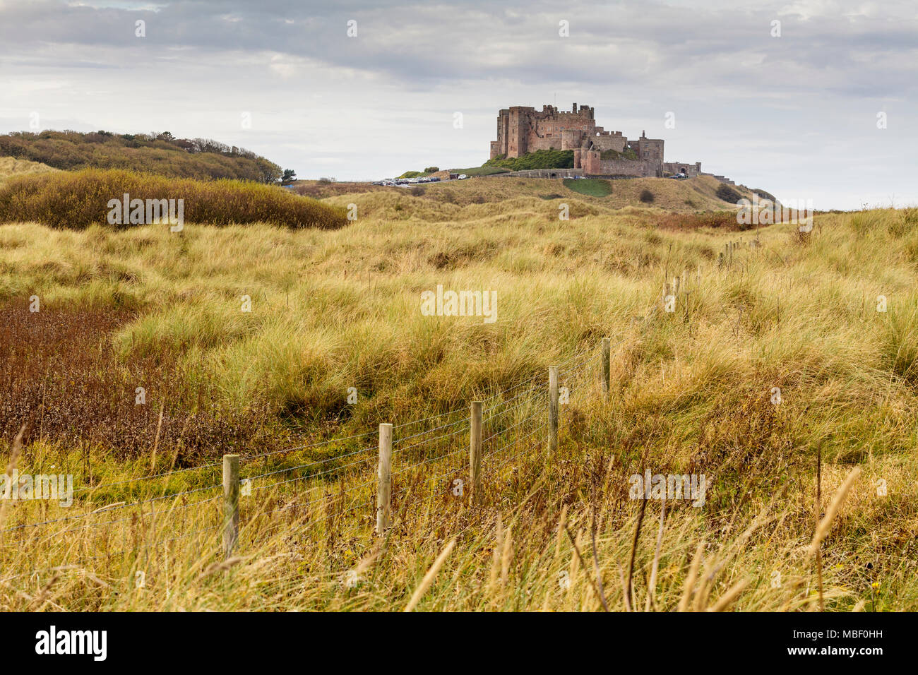Bamburgh Castle looking east on the Northumberland Coast - Stock Image