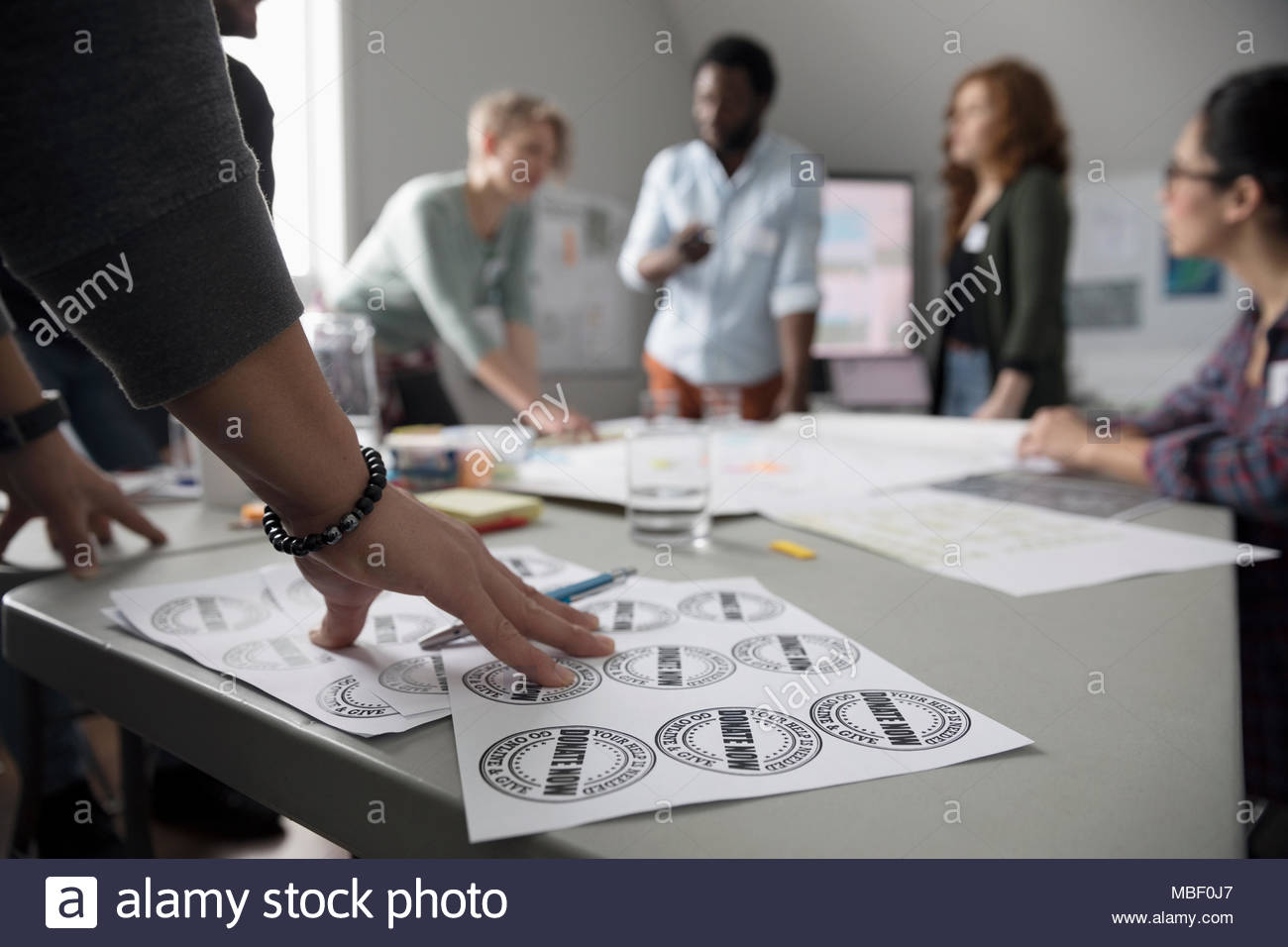 Activists preparing fundraiser donation stickers - Stock Image