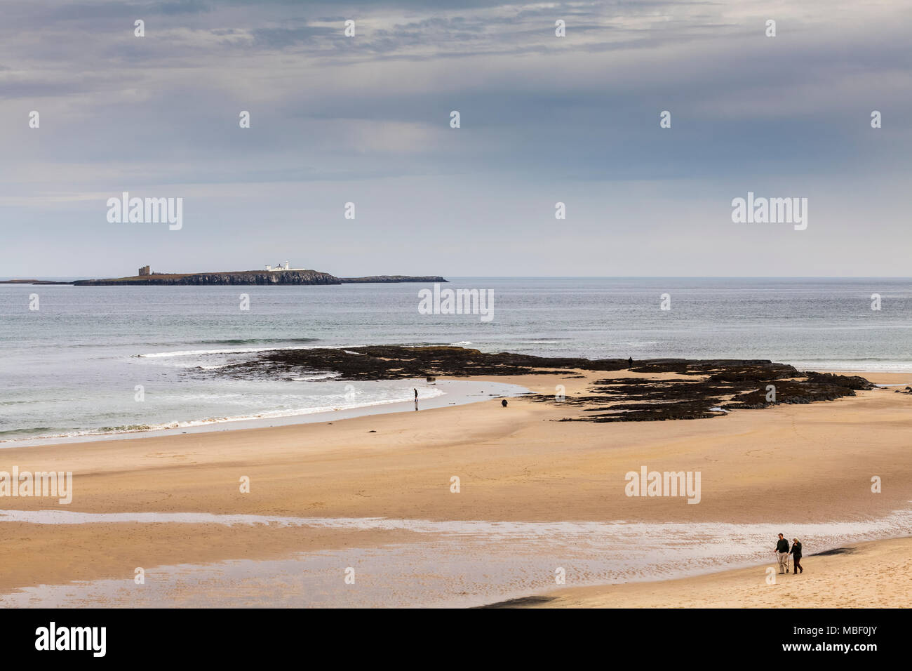 Bamburgh Beach with the Farne Islands in the background. - Stock Image