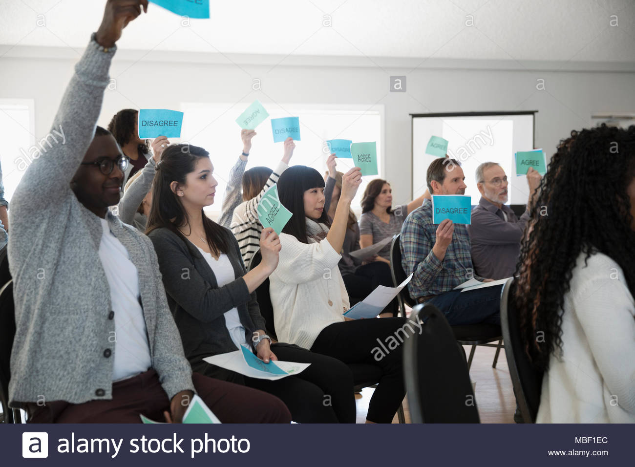 Audience voting at town hall meeting - Stock Image