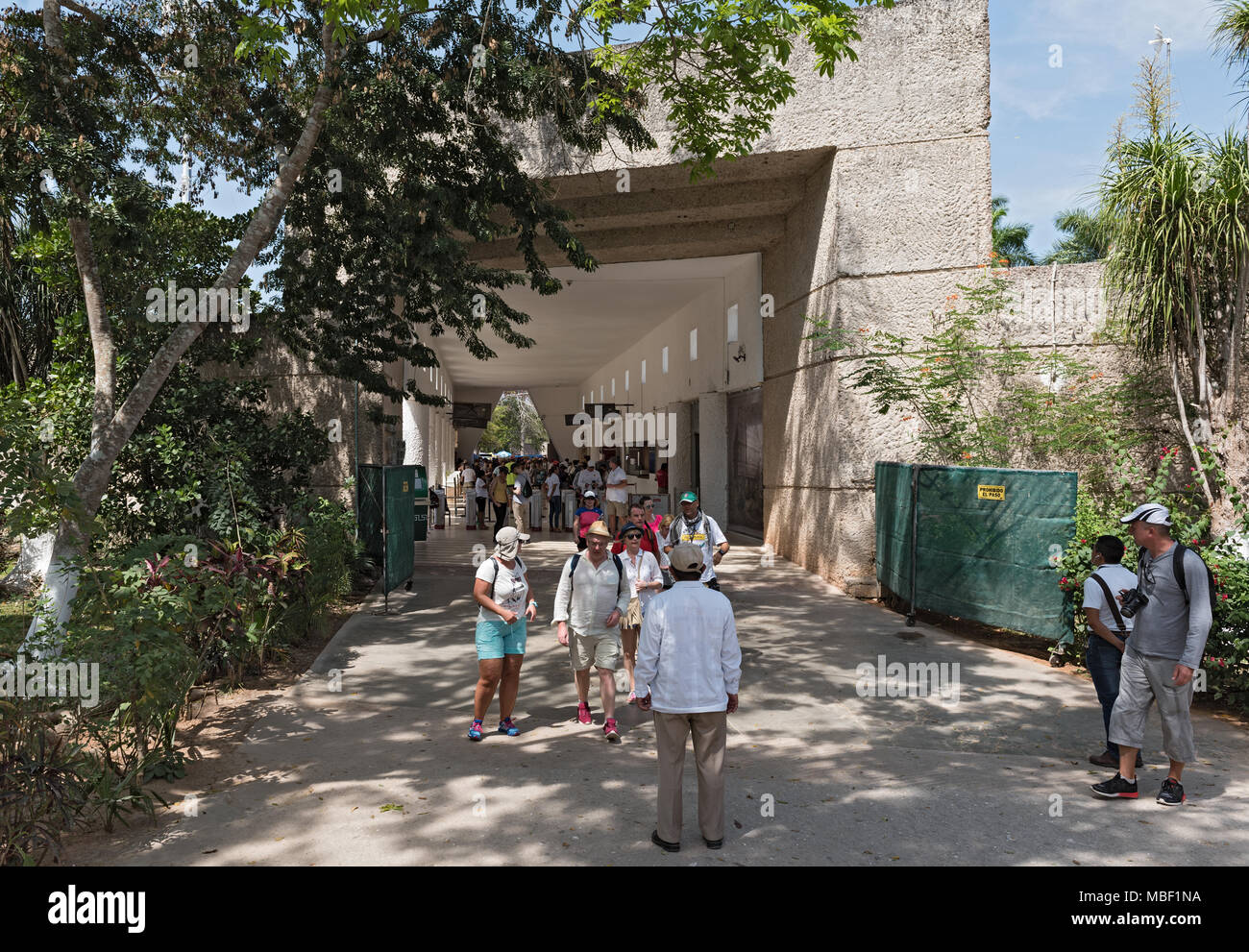 view of a group of unidentified tourists in the entrance area of chichen itza, yucatan, mexico - Stock Image