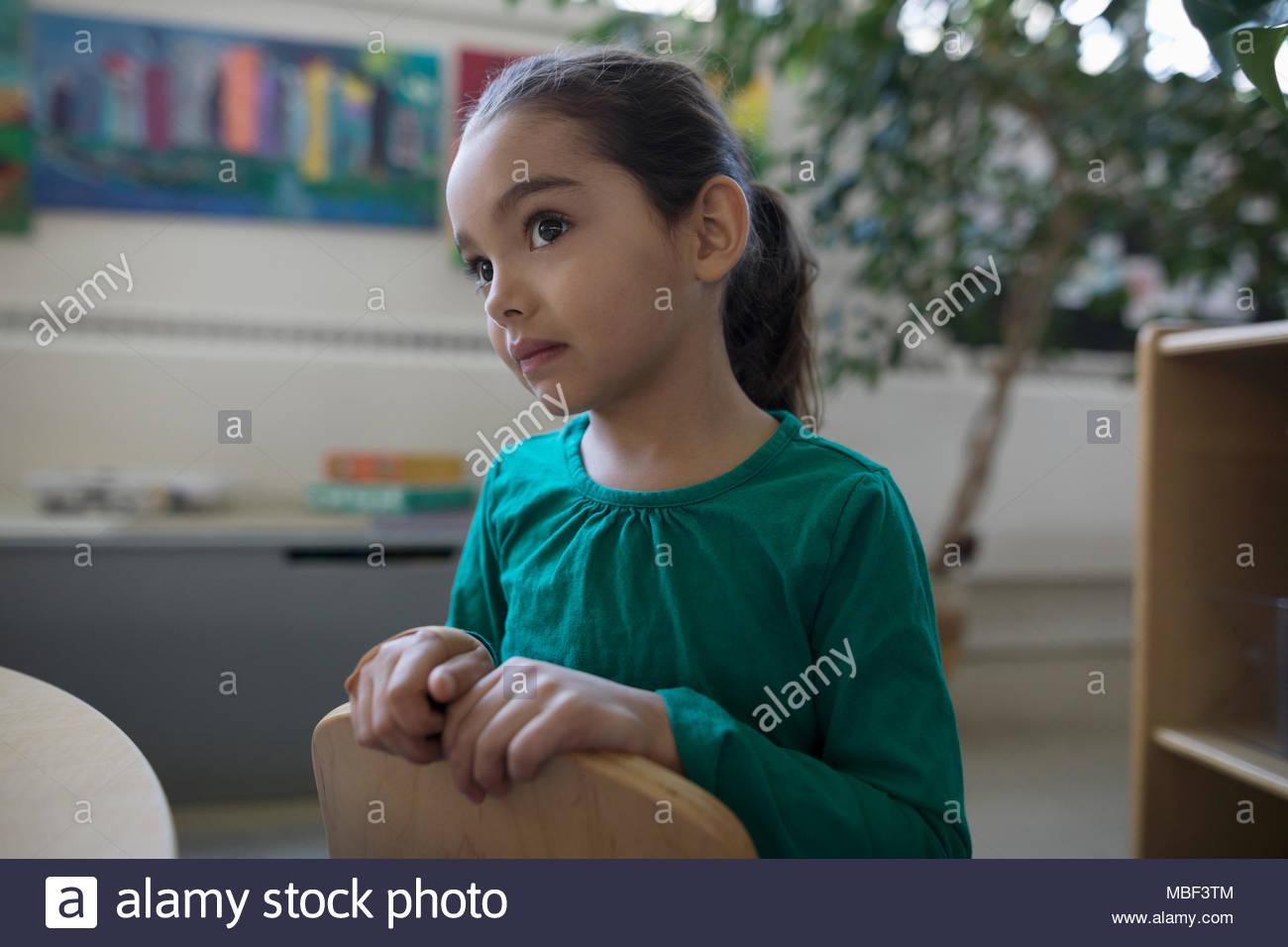 Focused, attentive preschool girl - Stock Image