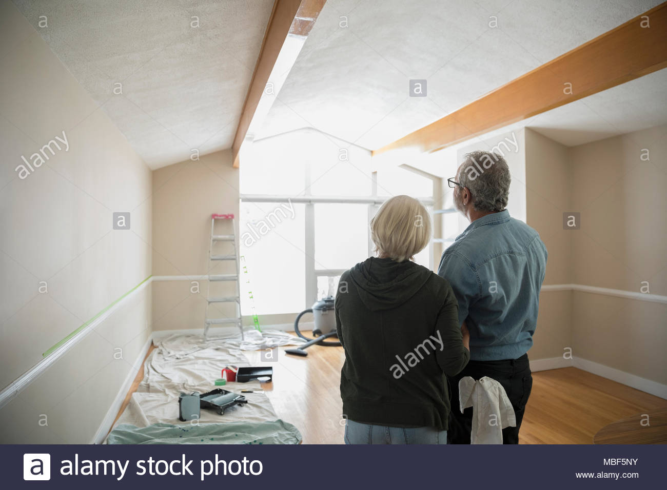 Senior couple preparing to paint living room, DIY - Stock Image