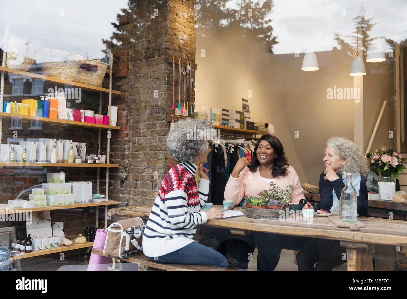 Women friends drinking tea at cafe shop Stock Photo