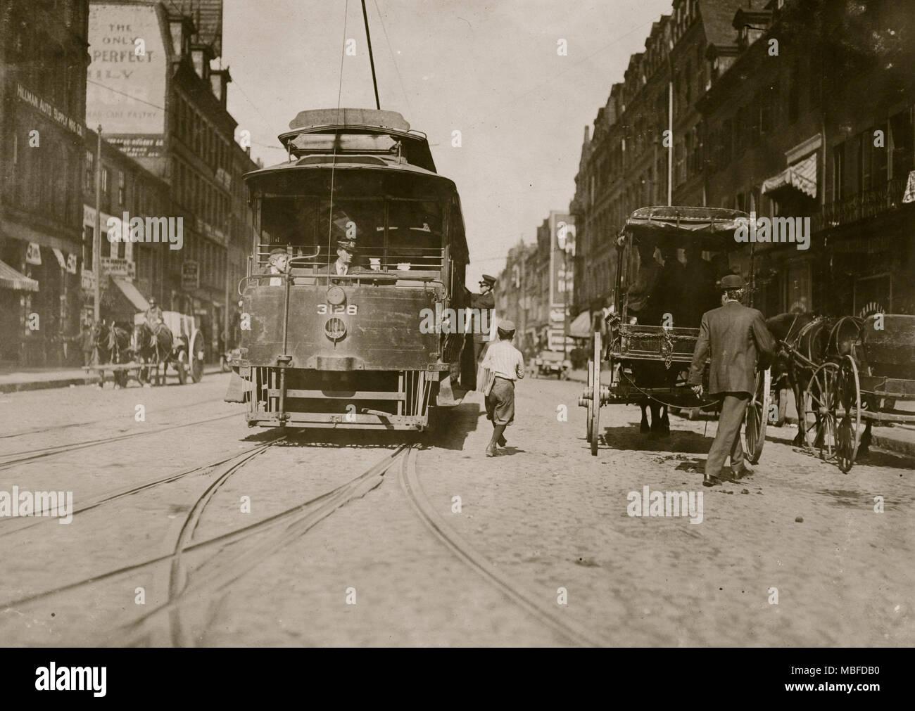 Trolleys & Cars - Stock Image