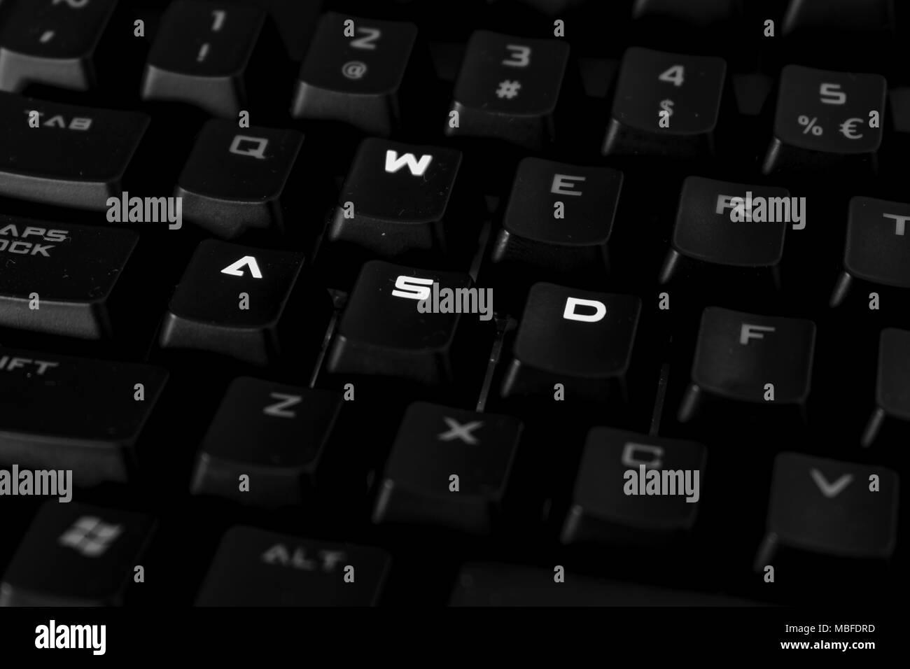 WASD keys on gaming keyboard close up, backlit keys - Stock Image