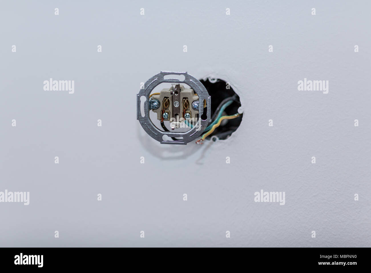wall-mounted AC power socket on a white wall Stock Photo: 179211228 ...