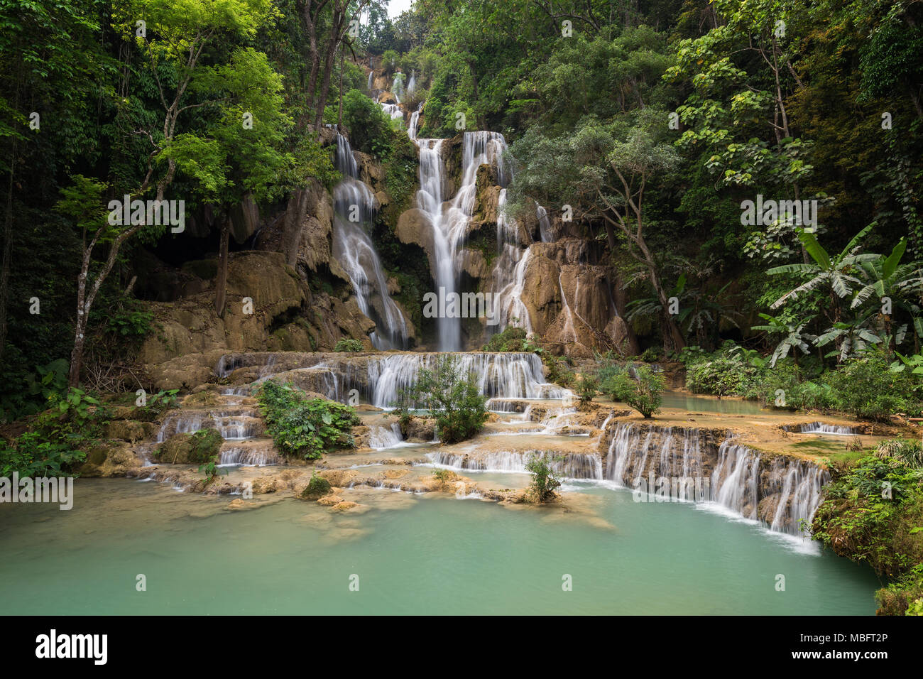 Beautiful view of the main fall at the Tat Kuang Si Waterfalls near Luang Prabang in Laos. - Stock Image