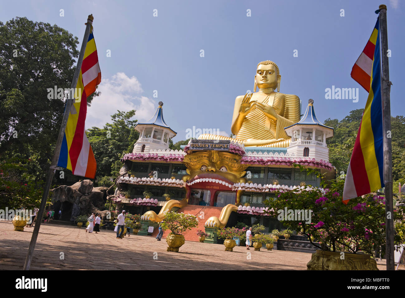 Horizontal view of the front entrance at the Golden Temple in Dambulla, Sri Lanka. - Stock Image