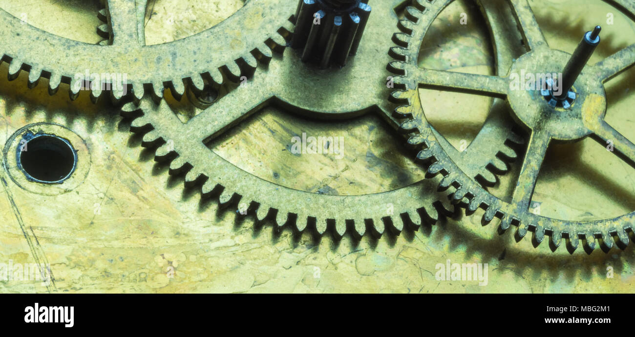 Beautiful macro close-up on clockwork mechanism with gears. Illustrative concept of machinery, technology engineering, thinking, intellectual concept. - Stock Image