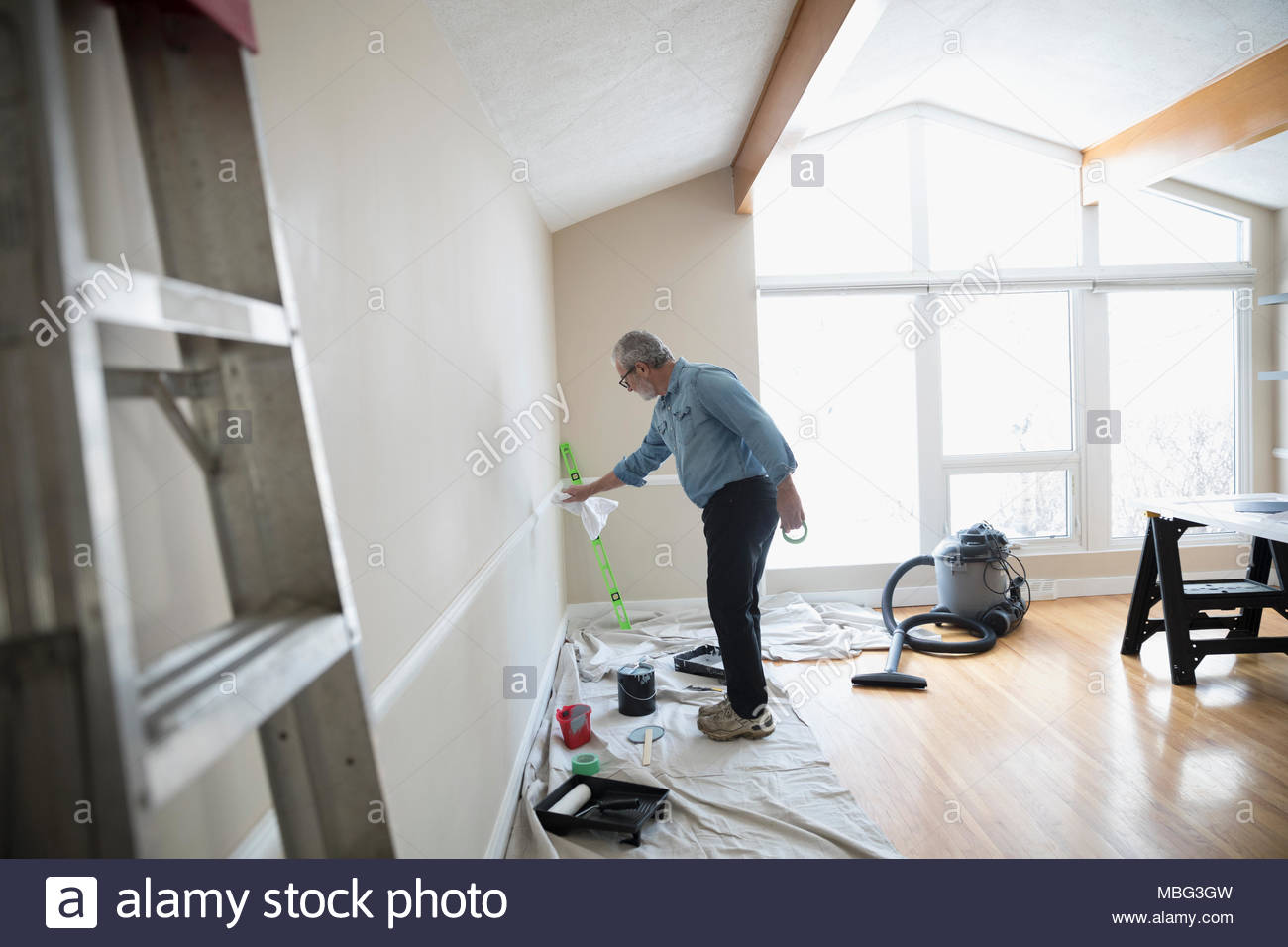 Chair Rail Orientation Part - 49: Senior Man Painting Chair Rail In Living Room, DIY - Stock Image
