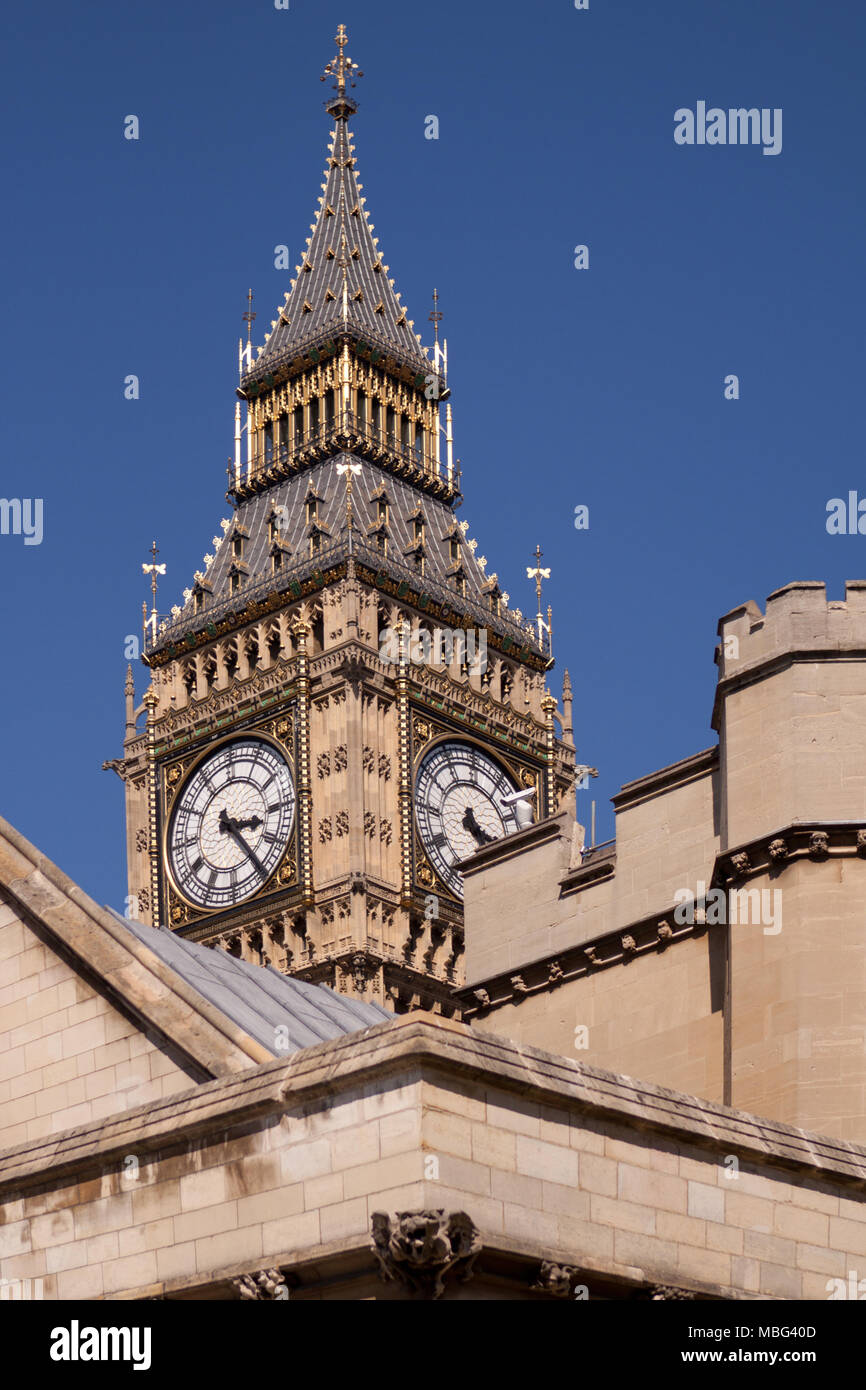 The Elizabeth (Clock) Tower at the Palace of Westminster, often known as Big Ben, glimpsed from St Margaret's Street to the southwest. London, UK - Stock Image