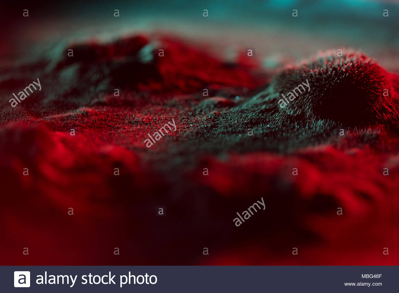 Microscopic red virus spore growth - Stock Image