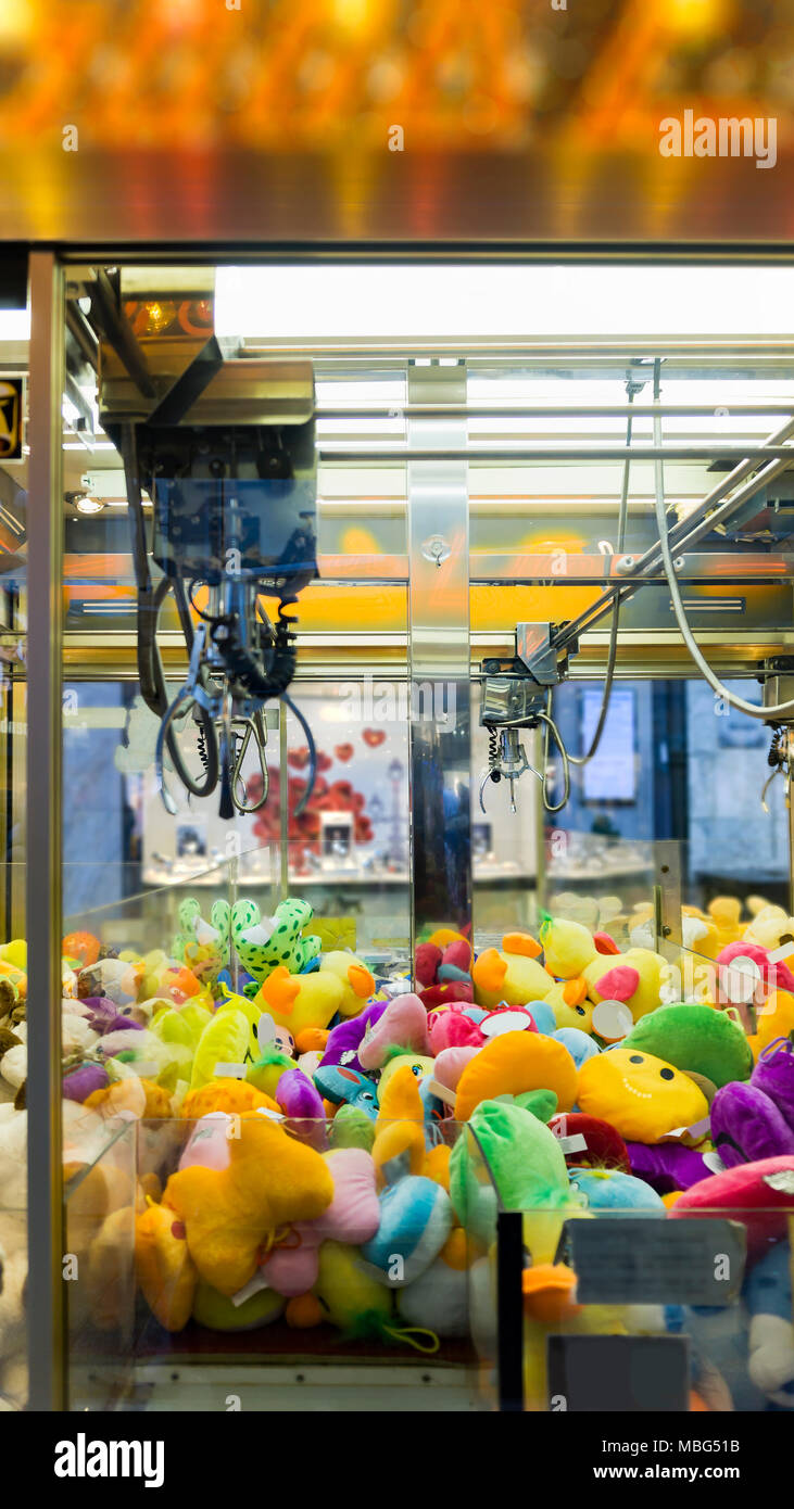 Claw crane - toy automat with plush animals - Stock Image