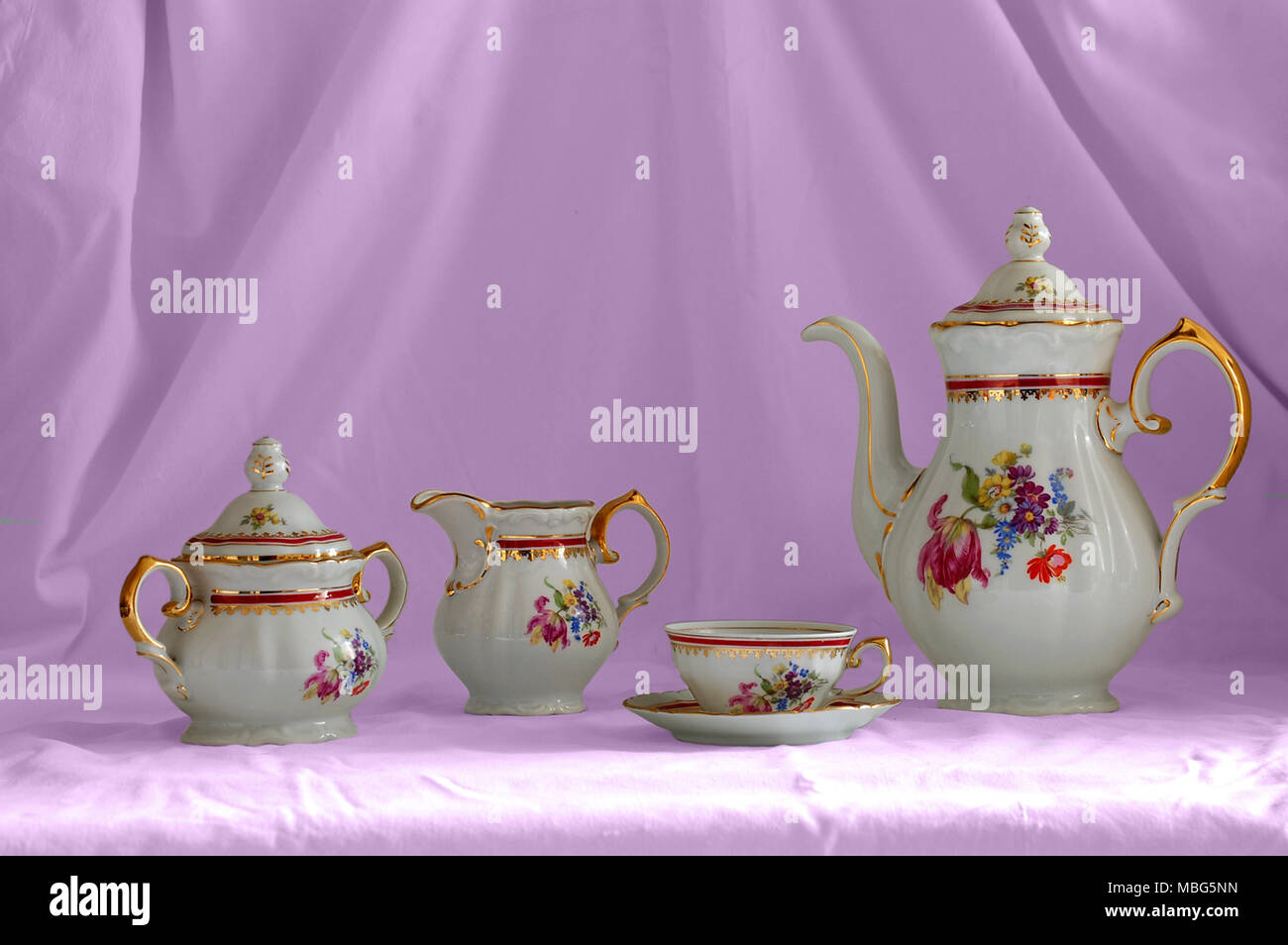 Porcelain coffee set classic pink background - Stock Image