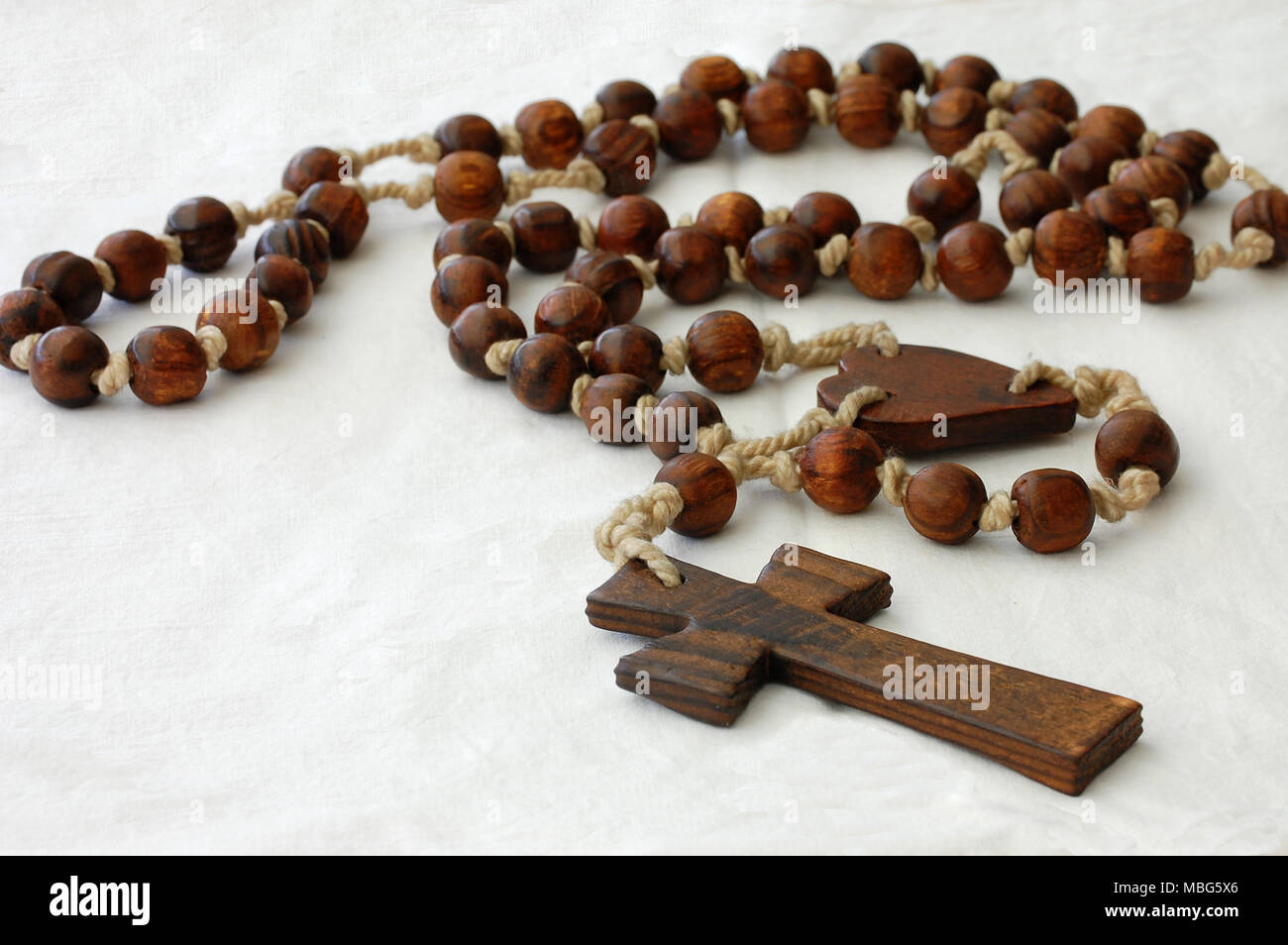 wooden rosary beads isolated  on white background - Stock Image