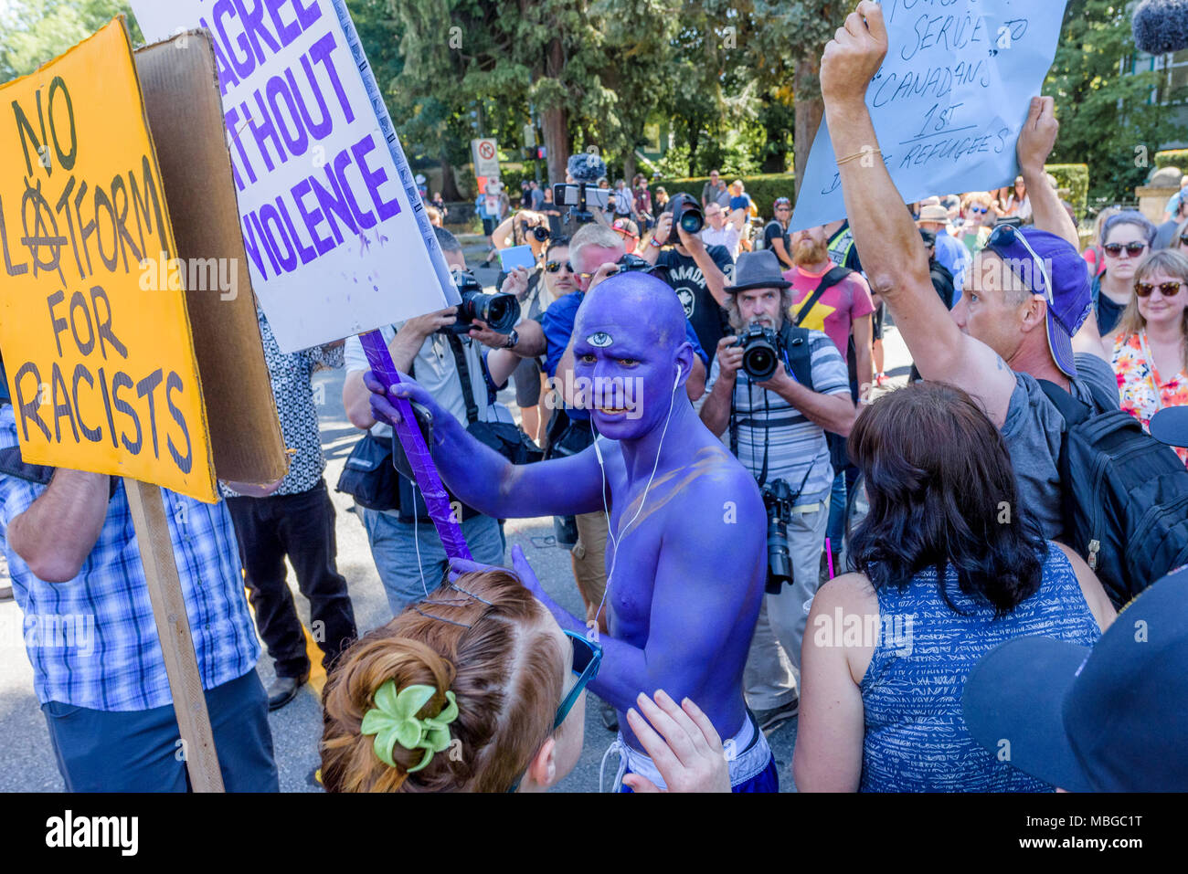 Man with third eye and blue body paint at Anti-Racism Rally, City Hall, Vancouver, British Columbia, Canada. - Stock Image