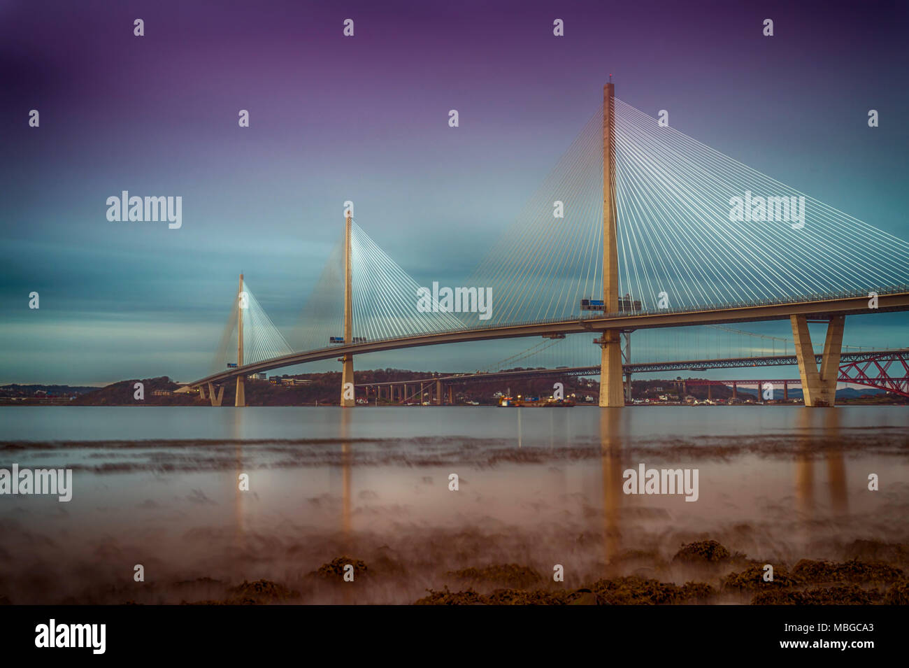 The Queensferry Crossing taken from the shore of the River Forth, more or less on the border between Edinburgh and West Lothian.    Opened in August 2 - Stock Image