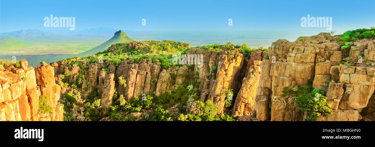 Panorama of Camdeboo National Park Valley of Desolation, Karoo in Eastern Cape near the town of Graaff-Reinet, South Africa. Summer season. Blue sky. Banner with copy space. - Stock Image