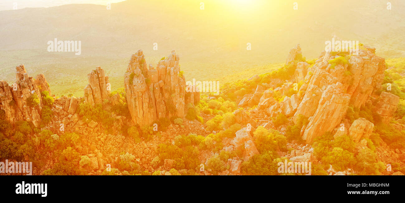 Panorama of Valley of Desolation also called The Cathedral of the Mountains, in Camdeboo National Park with sunset light. Karoo in Eastern Cape near Graaff-Reinet, South Africa. Banner with copy space - Stock Image