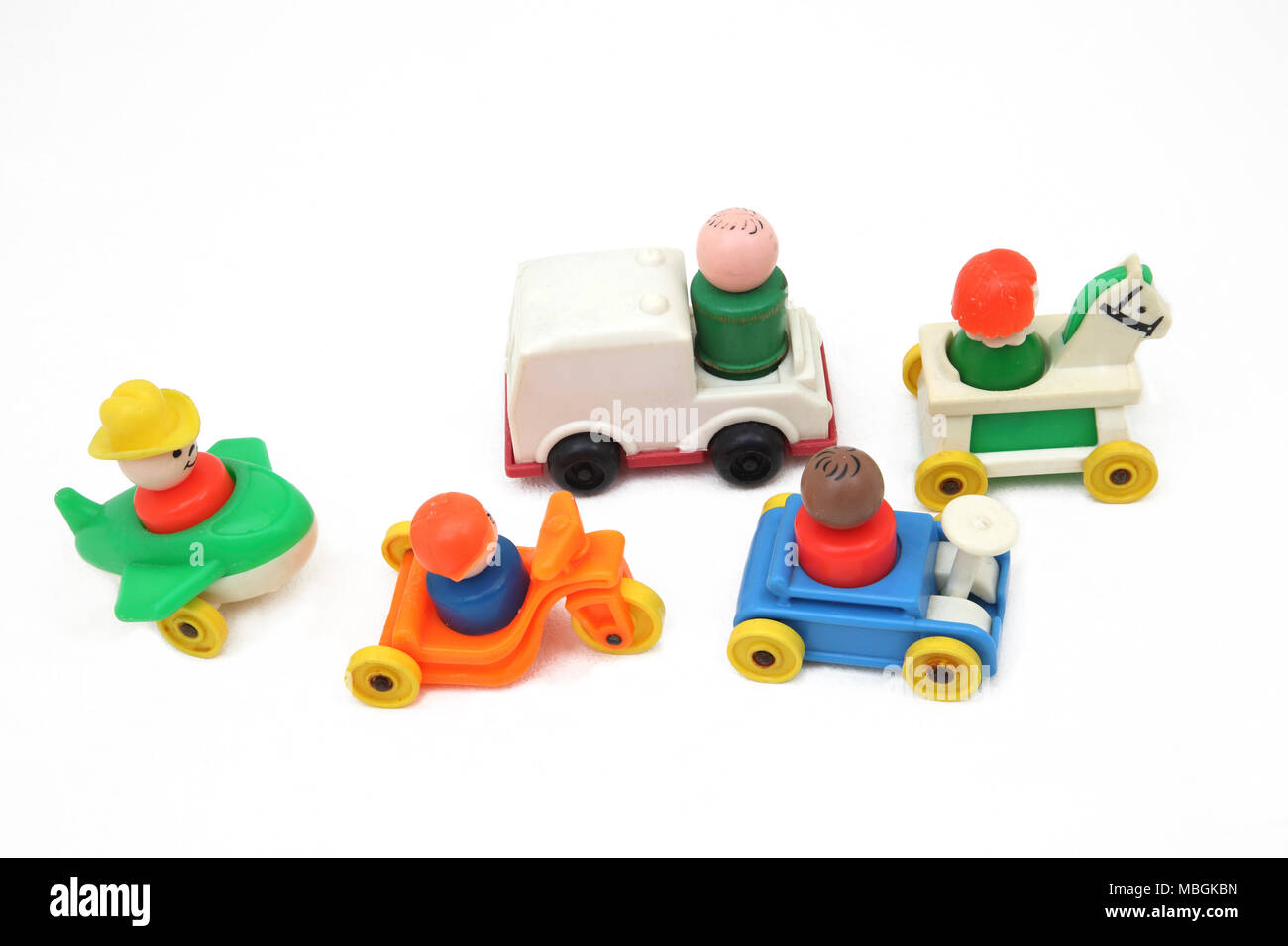 Vintage Fisher Price Little People in Cars, Aeroplane, Tricyle and Rocking Horse - Stock Image