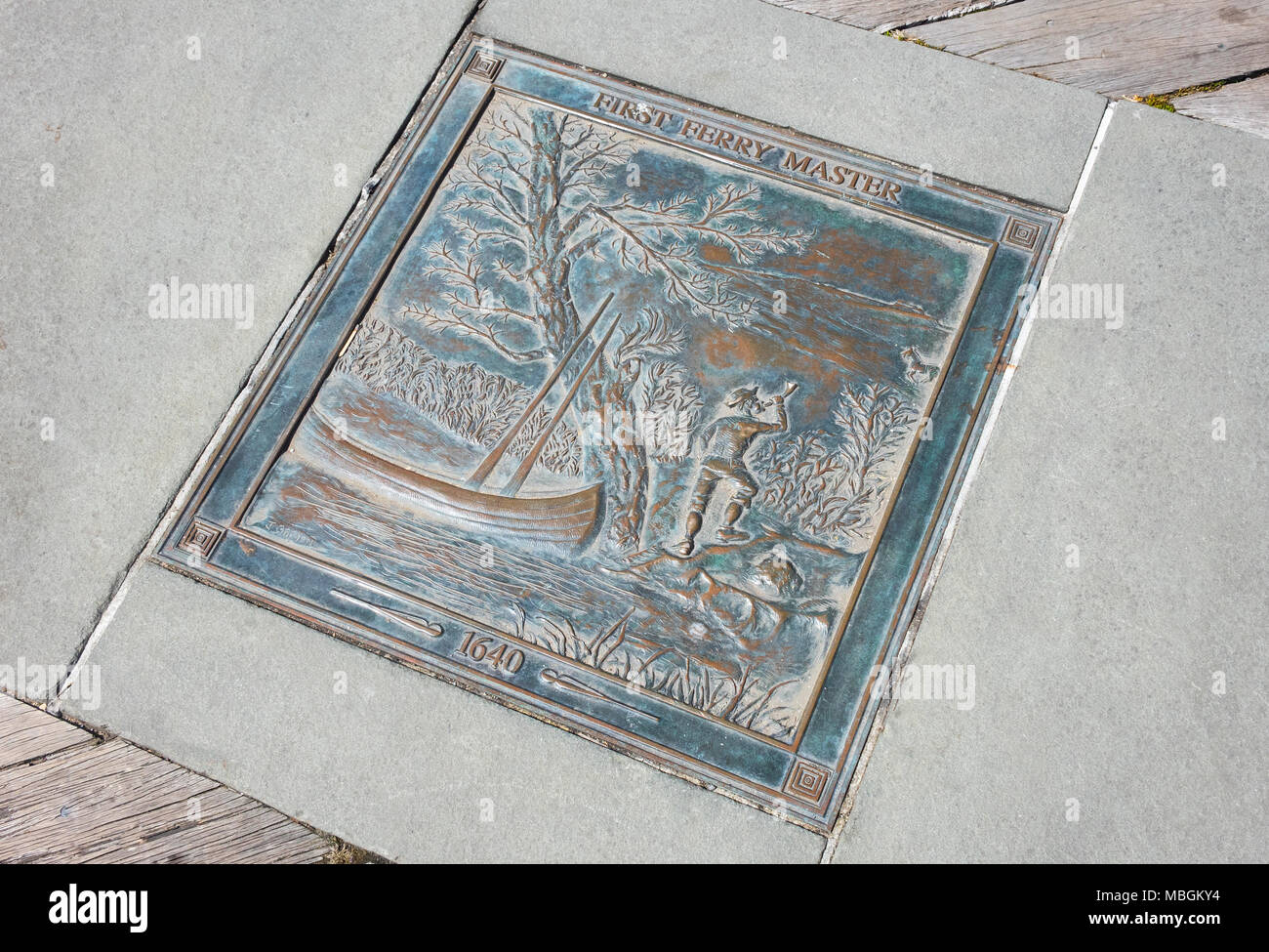 Memorial plaque set into the dock at Dumbo, Brooklyn to commemorate the first ferry master in charge of crossings on the East River in 1640 - Stock Image