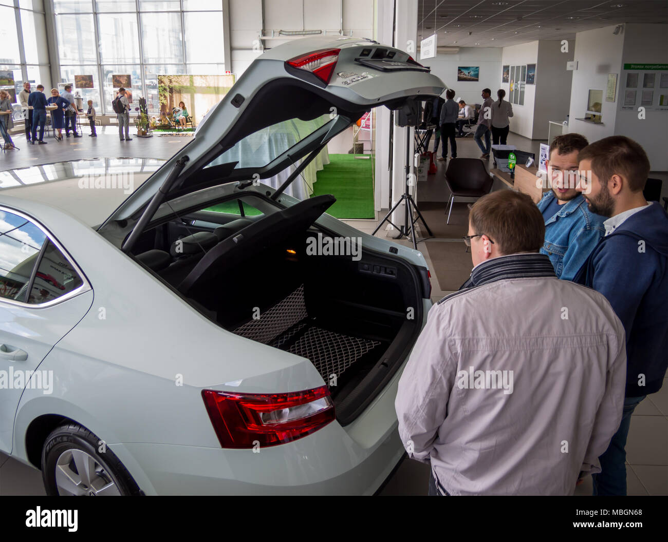 Voronezh, Russia - June 04, 2017: Buyers evaluate the trunk of a new car - Stock Image