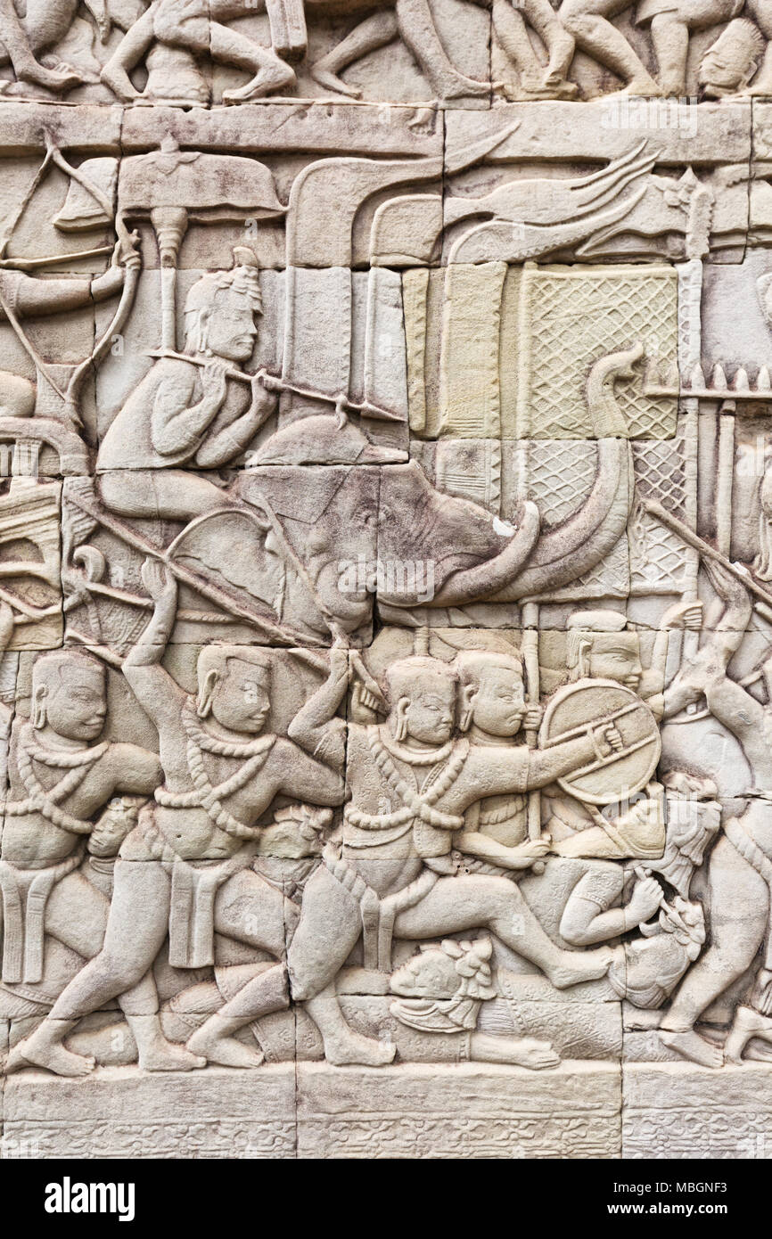 Ancient carvings of a battle scene between the Khmer and the Jain peoples, Bayon temple, Angkor Thom, Angkor UNESCO World heritage site, Cambodia Asia - Stock Image