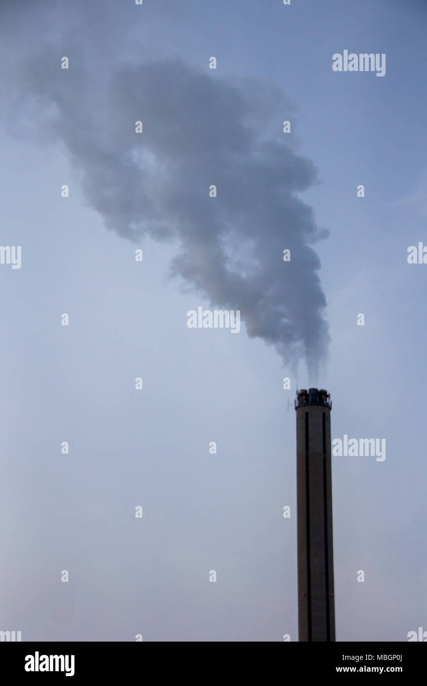 Chimney smoking stack. Air pollution and climate change theme. Poor environment in the city. Environmental disaster. Harmful emissions into the enviro Stock Photo