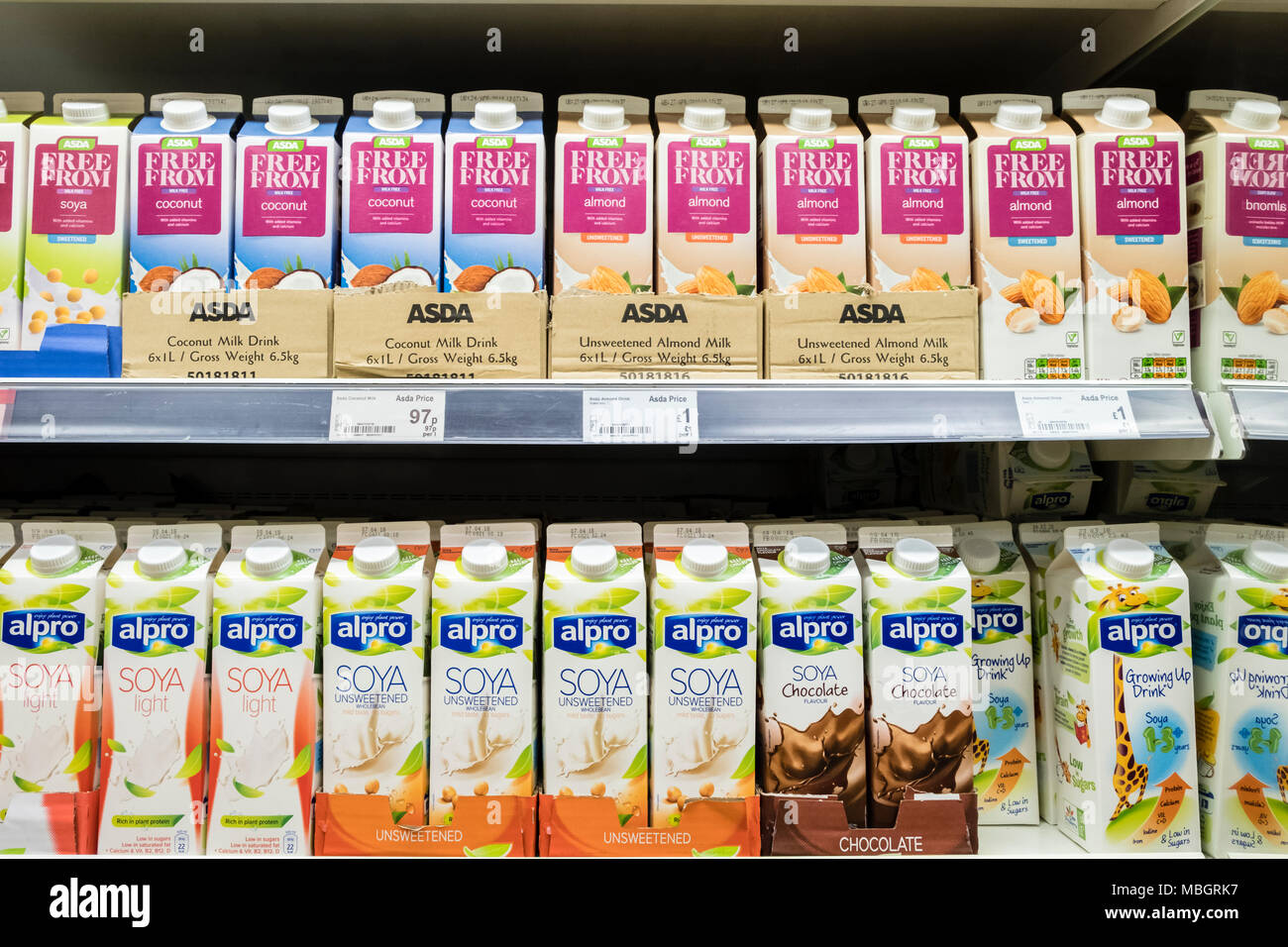 Alpro and Asda own brand soya milk and 'Free From' drinks on UK supermarket shelves at Asda - Stock Image