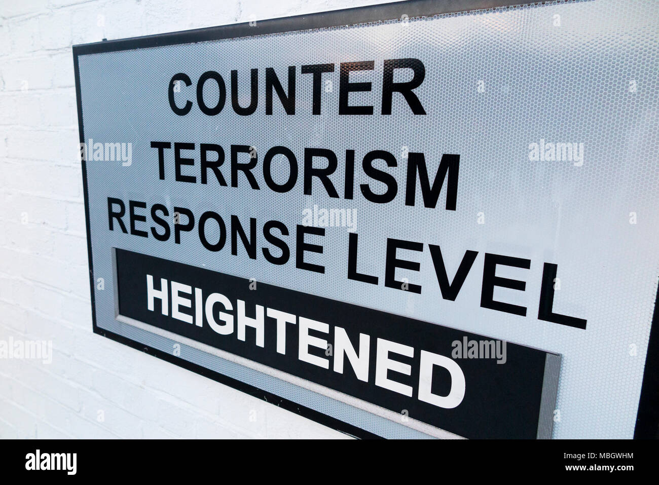Warning sign at the historic Naval dockyard, Portsmouth, to show heightened counter terrorism threat level in force at that time on the Naval base. UK - Stock Image