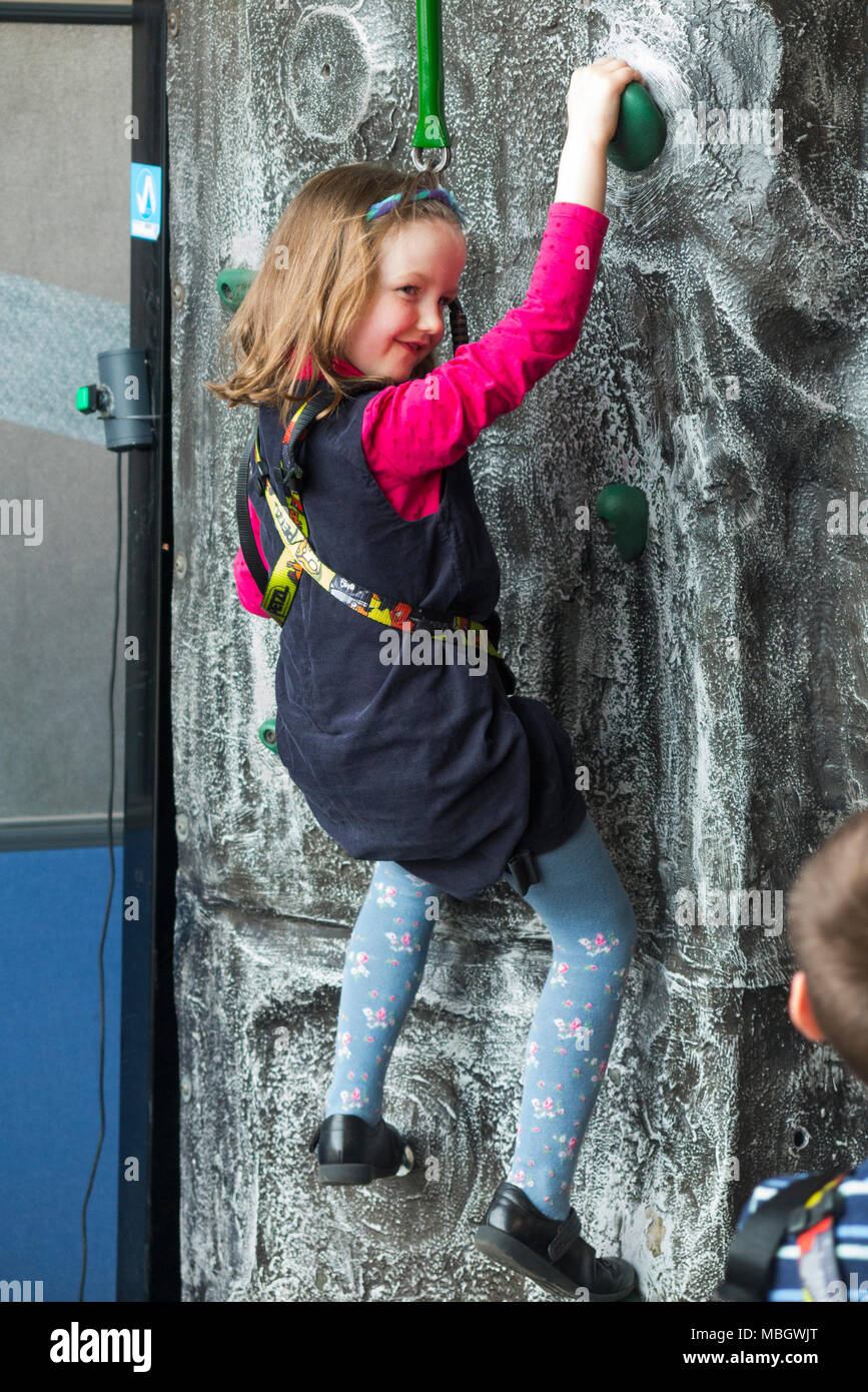 Young girl / child / kid / childrens activity on the climbing wall at Action Stations, Portsmouth Historic Dockyard. UK (95) - Stock Image