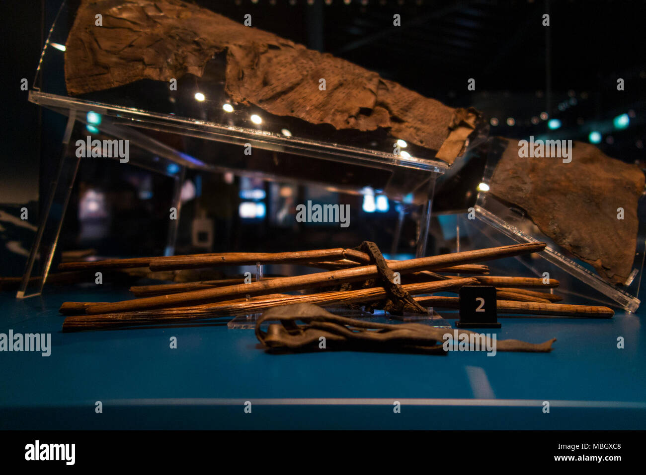 Arrows, bag – quiver – & an arrow spacer ; remains & artefacts found on wreck of The Mary Rose. The Mary Rose Museum, Portsmouth historic dockyard UK - Stock Image