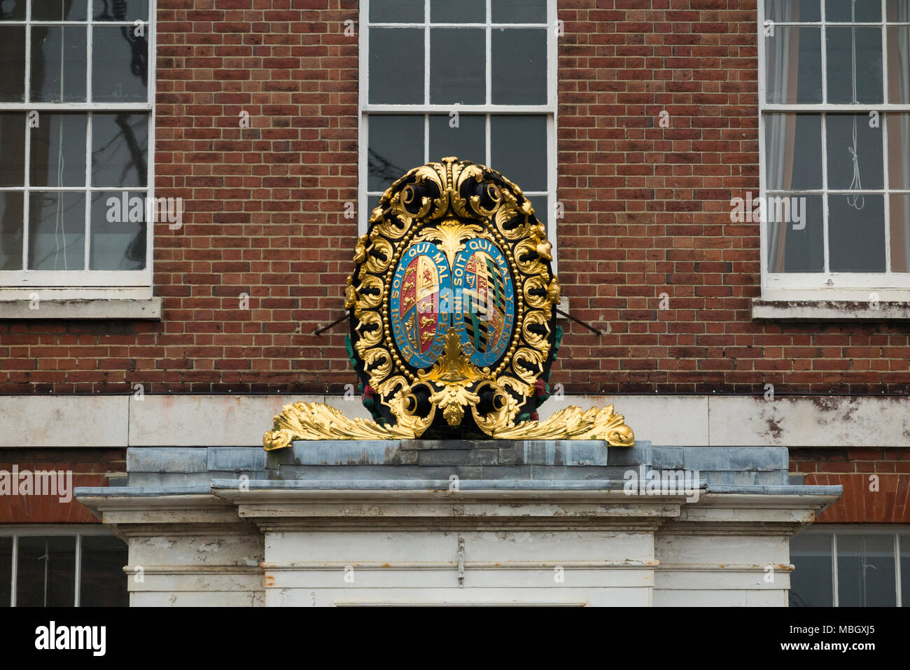 Crest / coat of arms that was removed the bow of HMS Victory ( Nelson's flagship at Battle of Trafalgar ) now placed on building. Portsmouth historic dockyard. UK - Stock Image