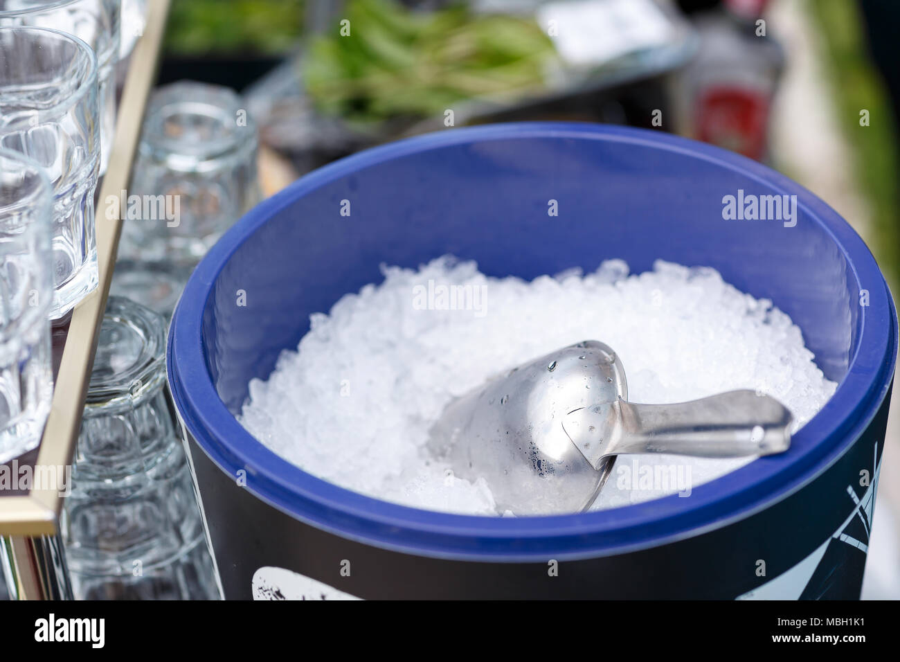 Ice Tube in Ice Bucket. Pieces of ice on a glass tray. The view from the top. - Stock Image