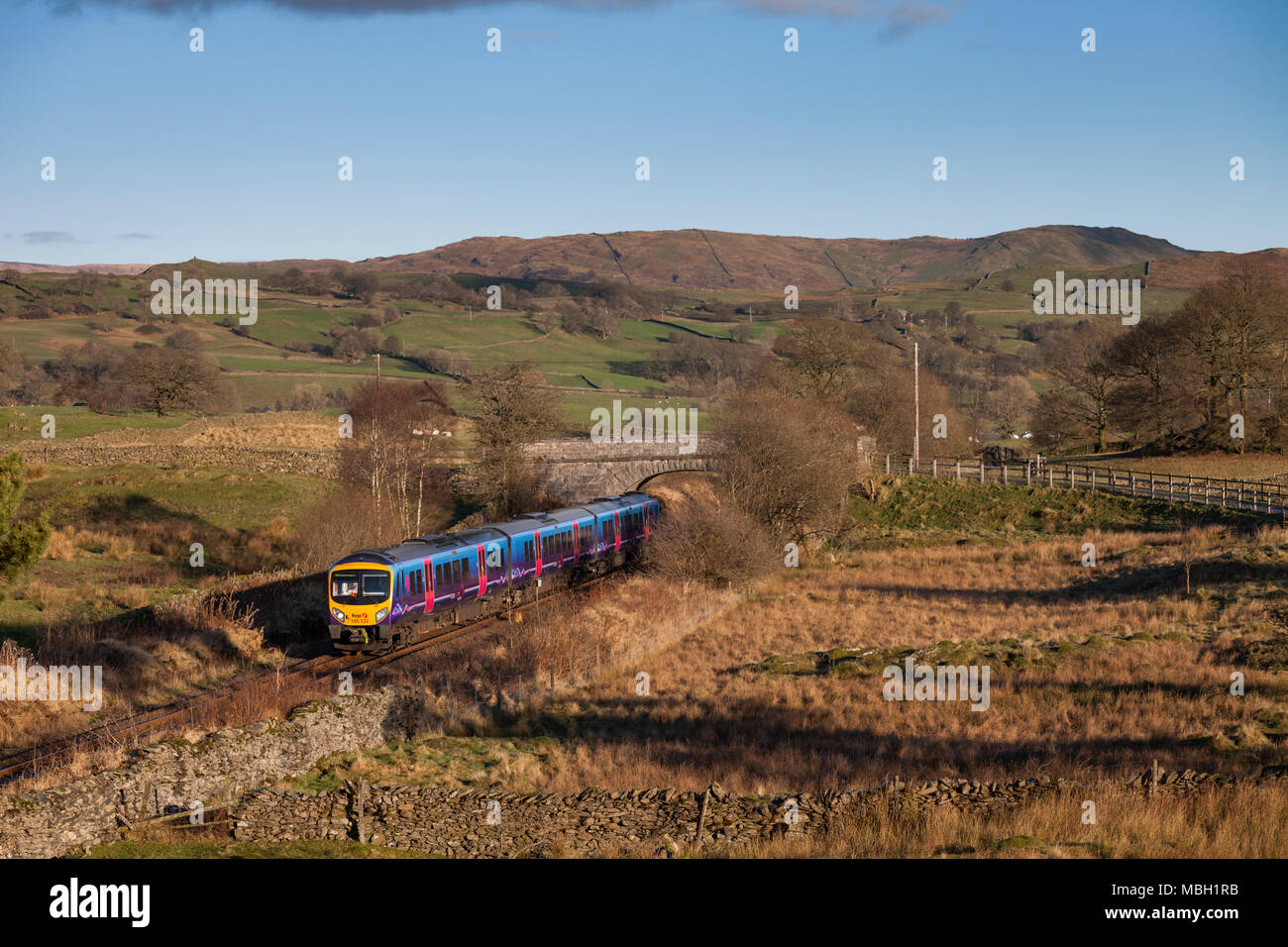 A First Transpennine Express class 185 train at Ings on the Oxenholme to Windermere railway line. - Stock Image