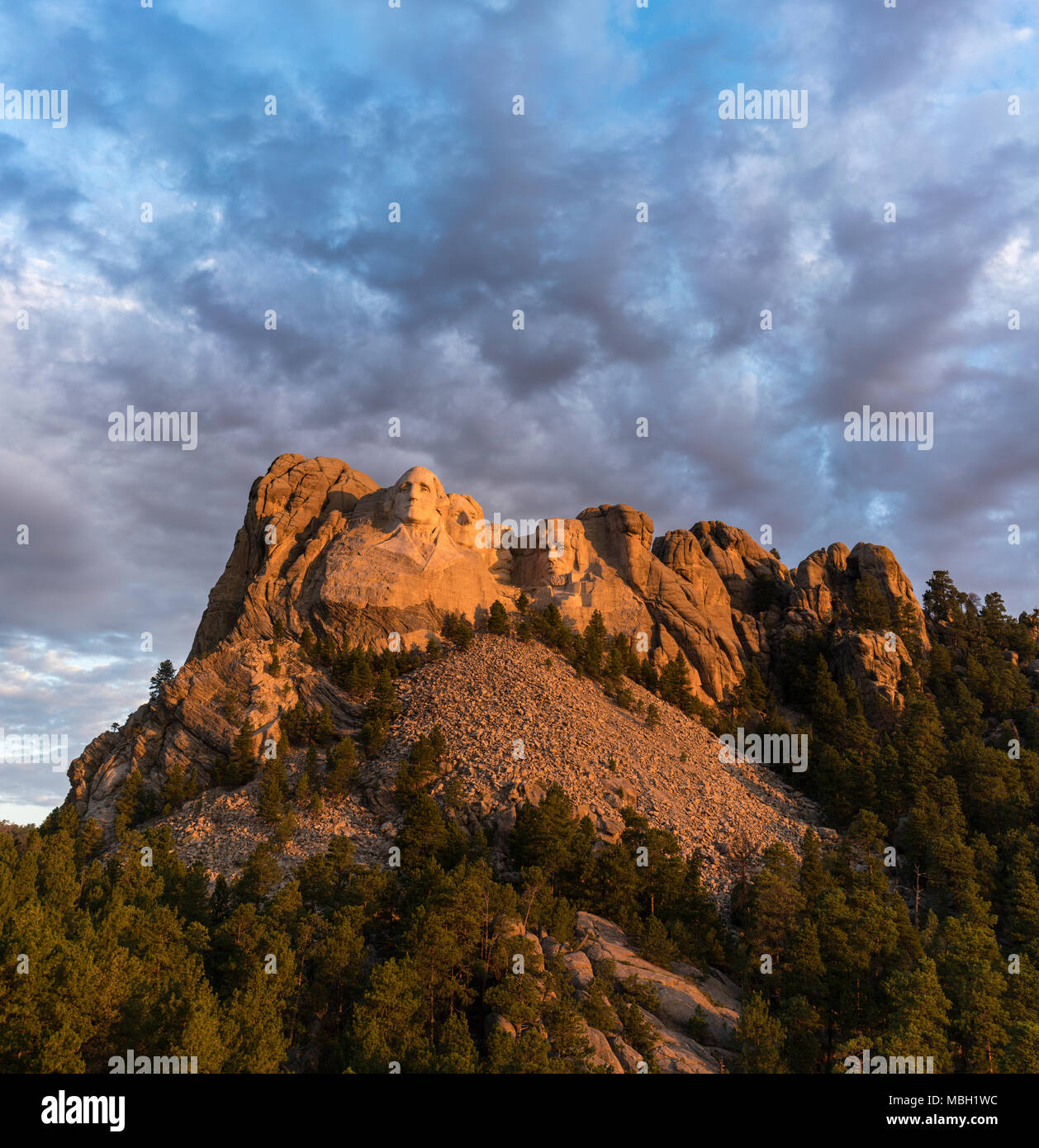 The faces of Washington, Jefferson, Roosevelt, and Lincoln at sunrise on Mount Rushmore in South Dakota. Stock Photo