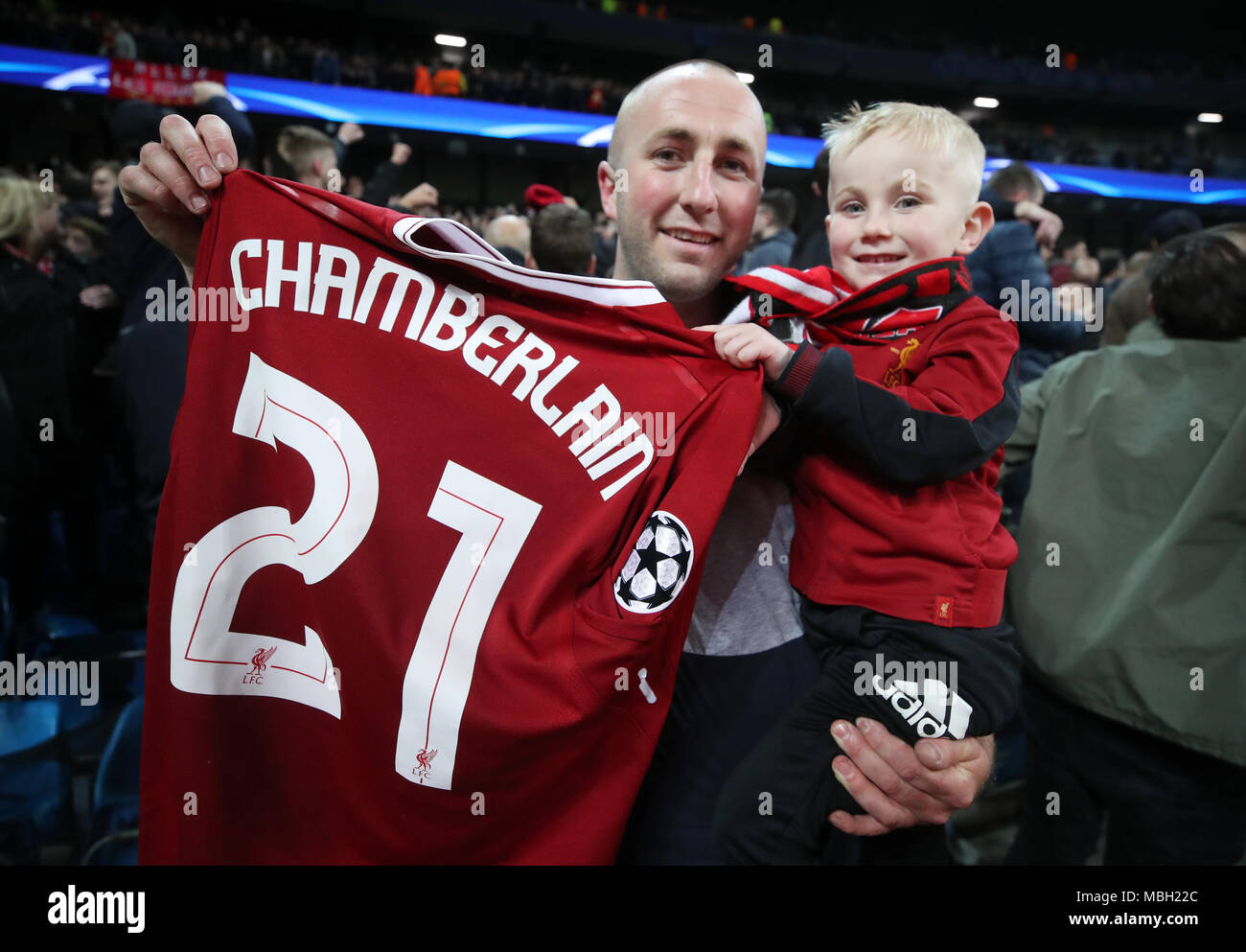 new style 2fcb7 e5bf3 Fans with Liverpool's Alex Oxlade-Chamberlain's shirt after ...