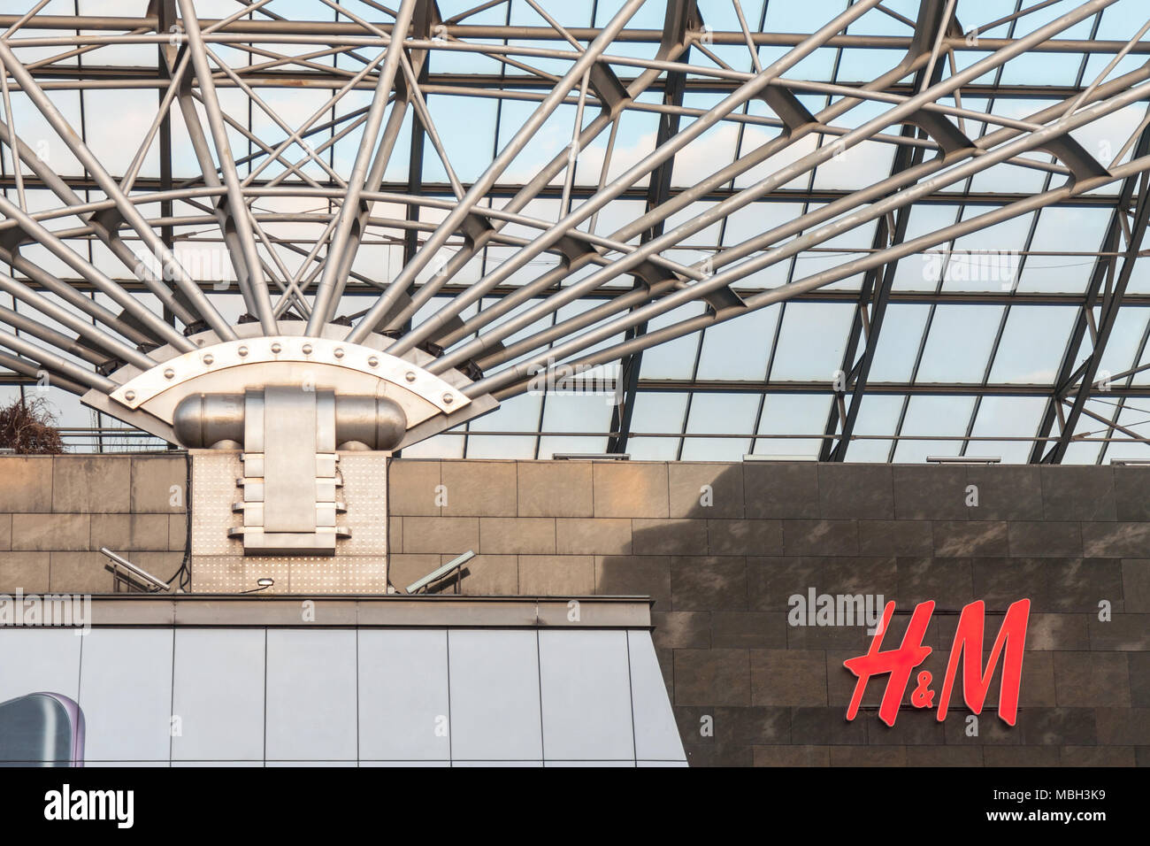 BUDAPEST, HUNGARY - APRIL 6, 2018:  Logo H&M store on a giant mall in the Hungarian capital city. H & M is a famous clothing retail firm  Picture of t - Stock Image