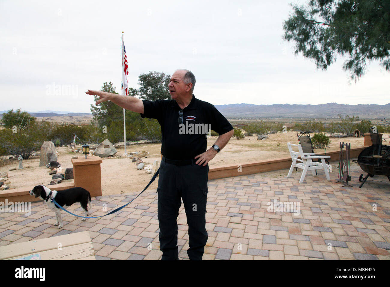 Father Michael McCullough, founder of the Desert Refuge for Peace Officers and Military Personnel, talks about the nonprofit organization's mission during a tour of the Joshua Tree, Calif., property March 7, 2018. McCullough is a Catholic priest and Los Angeles Police Department chaplain. - Stock Image