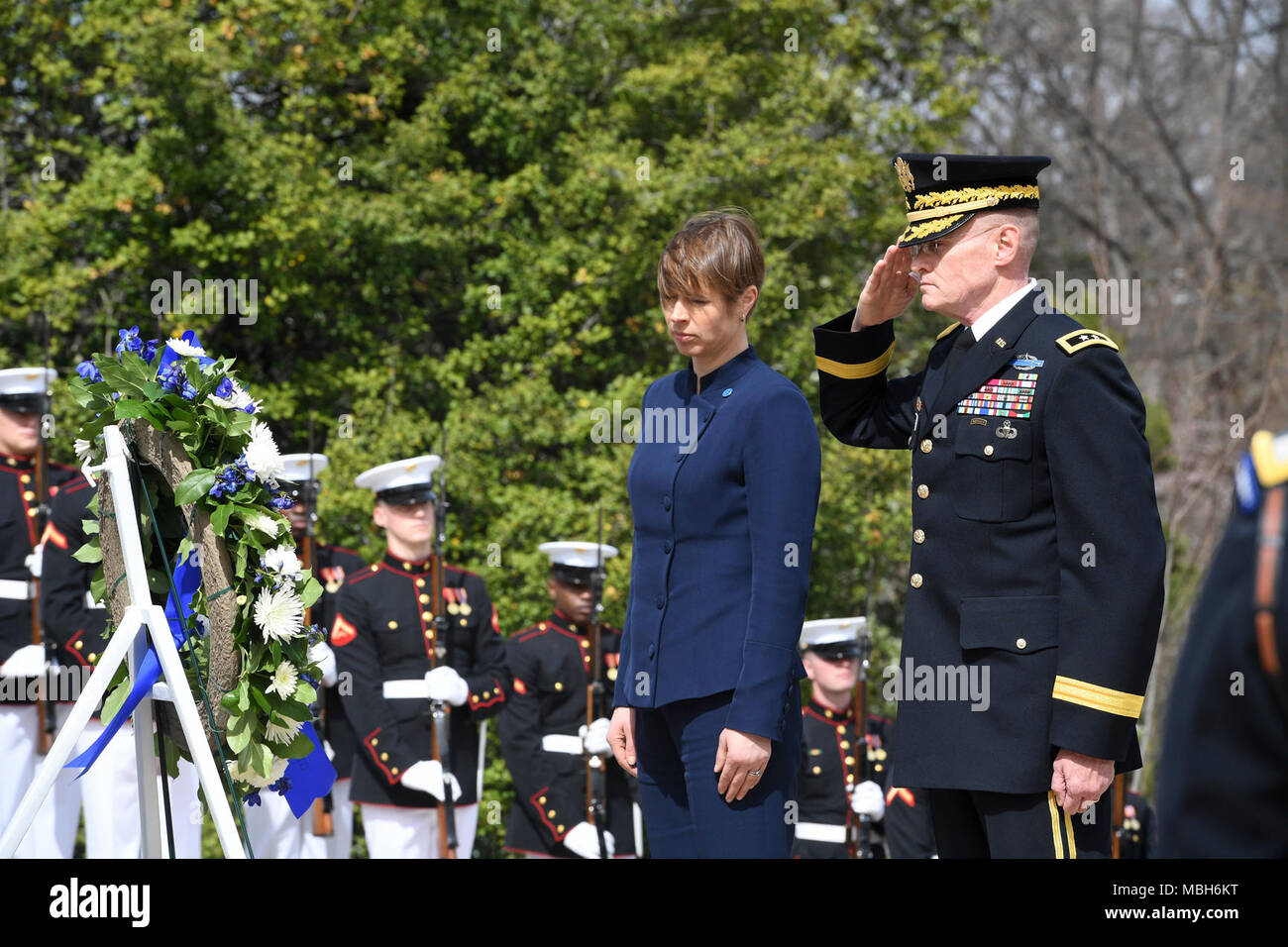 U.S. Army Maj. Gen. Michael L. Howard, commanding general, Joint Force Headquarters - National Capital Region and the U.S. Army Military District of Washington and Kersti Kaljulaid, President of Estonia, renders honor during an Armed Forces Full Honor Wreath Laying Ceremony at the Tomb of the Unknown Soldier, in Arlington National Cemetery, Va., April 4, 2018. Stock Photo