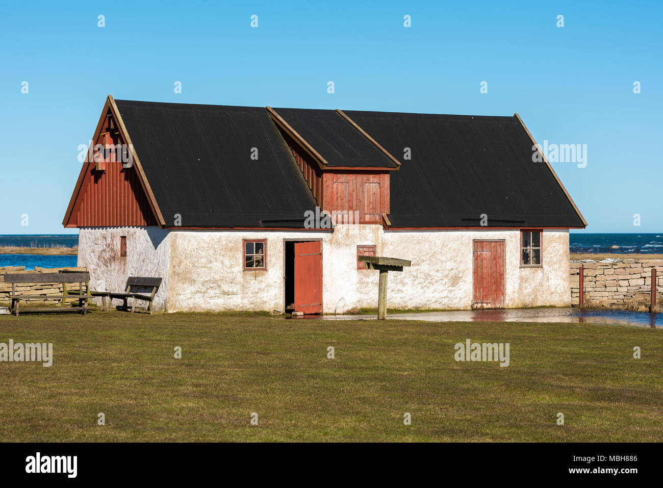 Ottenby, Sweden - April 6, 2018: Documentary of everyday life and environment. One of the buildings at the coastal bird station area. Lawn in front is - Stock Image