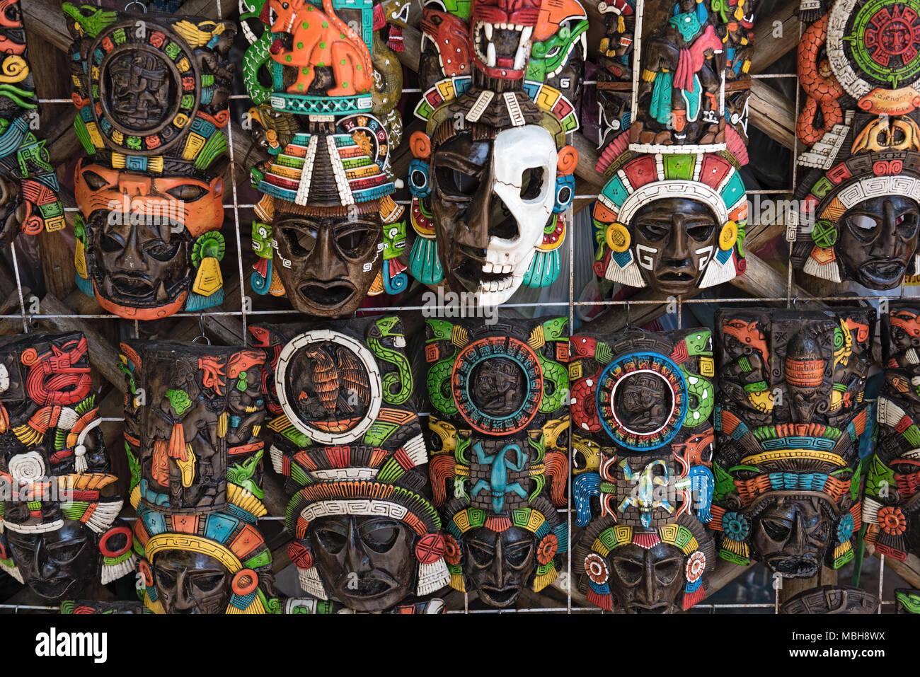 Colored wooden masks at a souvenir stand in Chichen Itza, Yucatan, Mexico - Stock Image