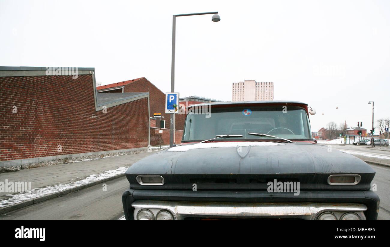 Big black old car in Islands Brygge, Copenhagen, Denmark - Stock Image