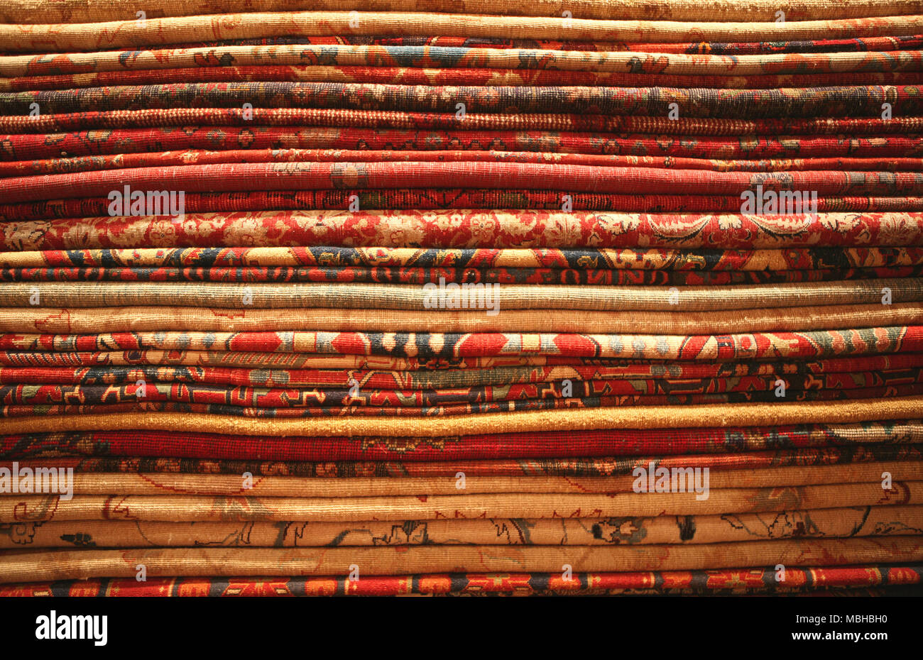 Pile of colorful oriental carpets - Stock Image