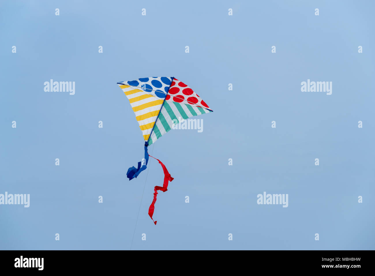 Low angle view of kite flying against clear sky - Stock Image
