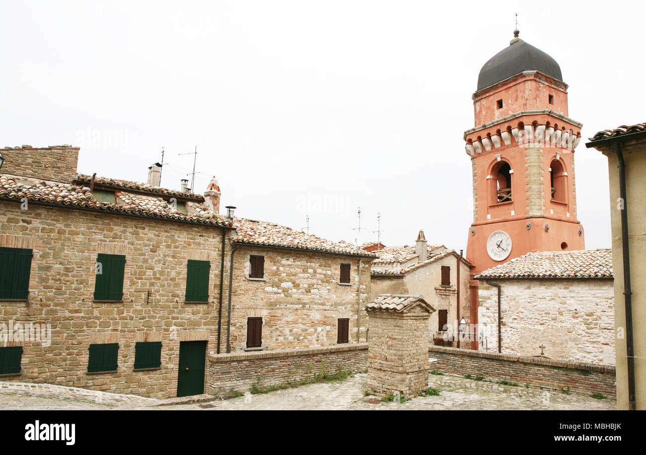 Bell Tower and stone houses, Frontone, Italy - Stock Image
