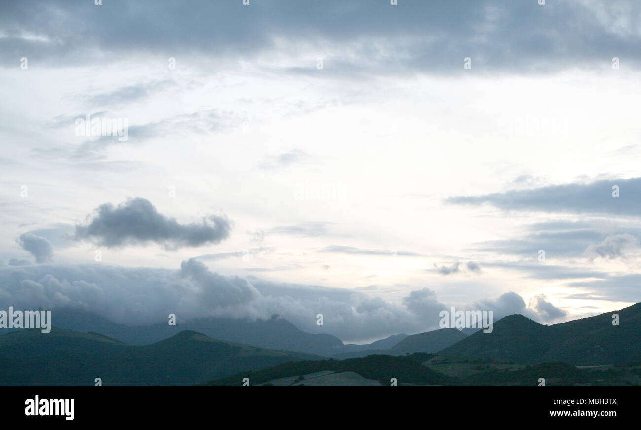 Cloudy sky overcast mountains landscape, Italy - Stock Image