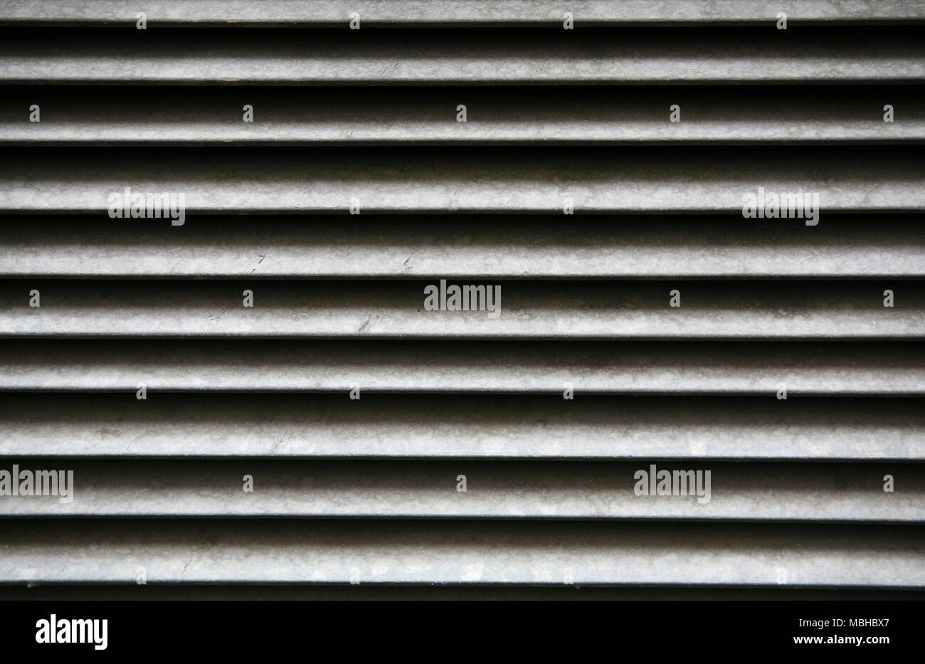Drain grates with light background texture - Stock Image